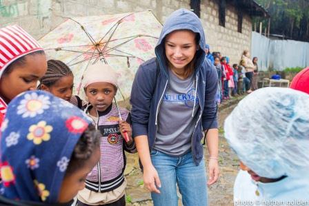 Emily Holsopple with children in Ethiopia.