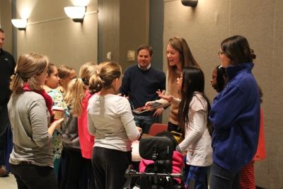 Ashley Morris, a senior research engineer at UK CAER, does a demonstration for fourth and fifth grade students at the Energy Fair Dec. 9 in the UK Student Center Grand Ballroom.
